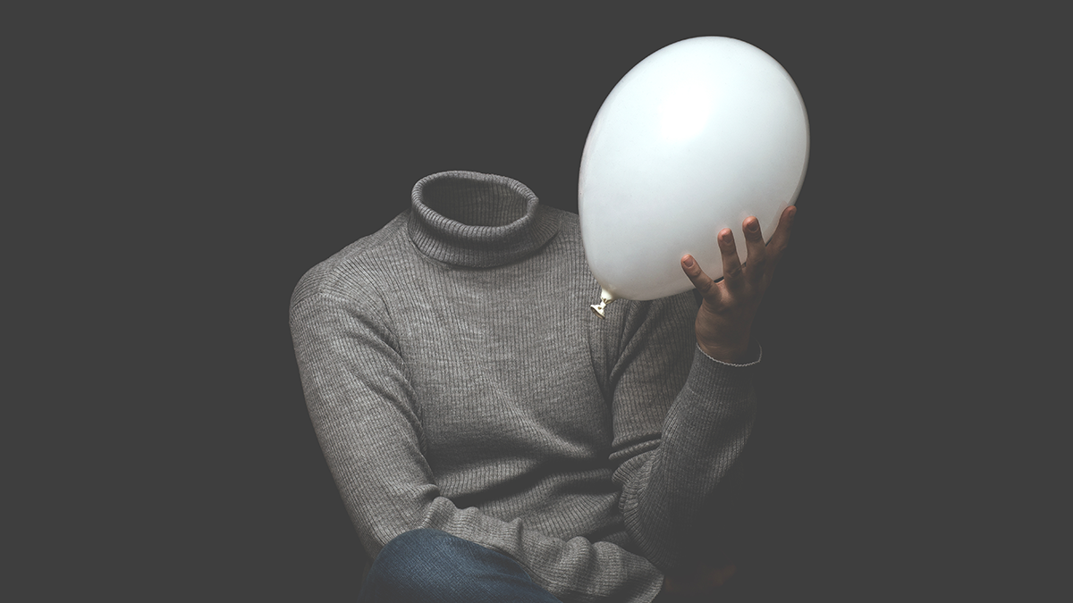 headless man with balloon in hand